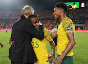 South Africa head coach Stuart Baxter celebrates with goalscorer Thembinkosi Lorch and midfielder Bongani Zungu after Bafana Bafana beat host nation Egypt 1-0 to book a place at the Africa Cup of Nations quarterfinals against Nigeria on Wednesday July 10 2019.