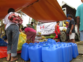 Photo: Water cans or jerry cans were as important as the food packs to enable families to store their drinking water