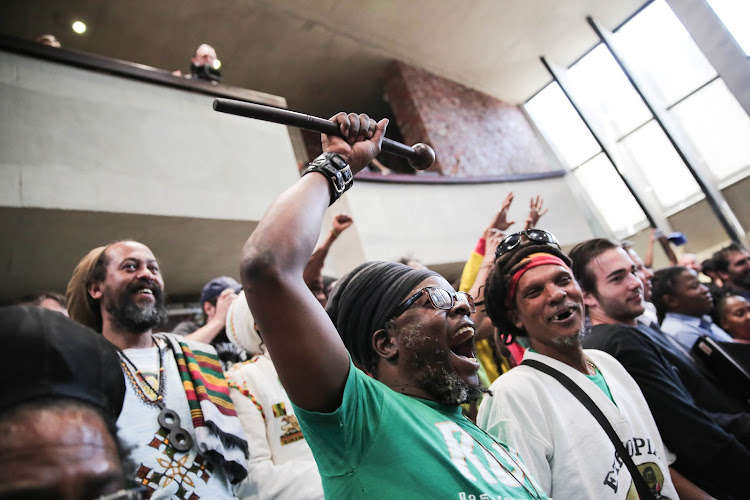 Marijuana lobbyists celebrate, 18 September 2018, inside the Constitutional court in Johannesburg, after the court ruled that the personal use of marijuana is not a criminal offence.