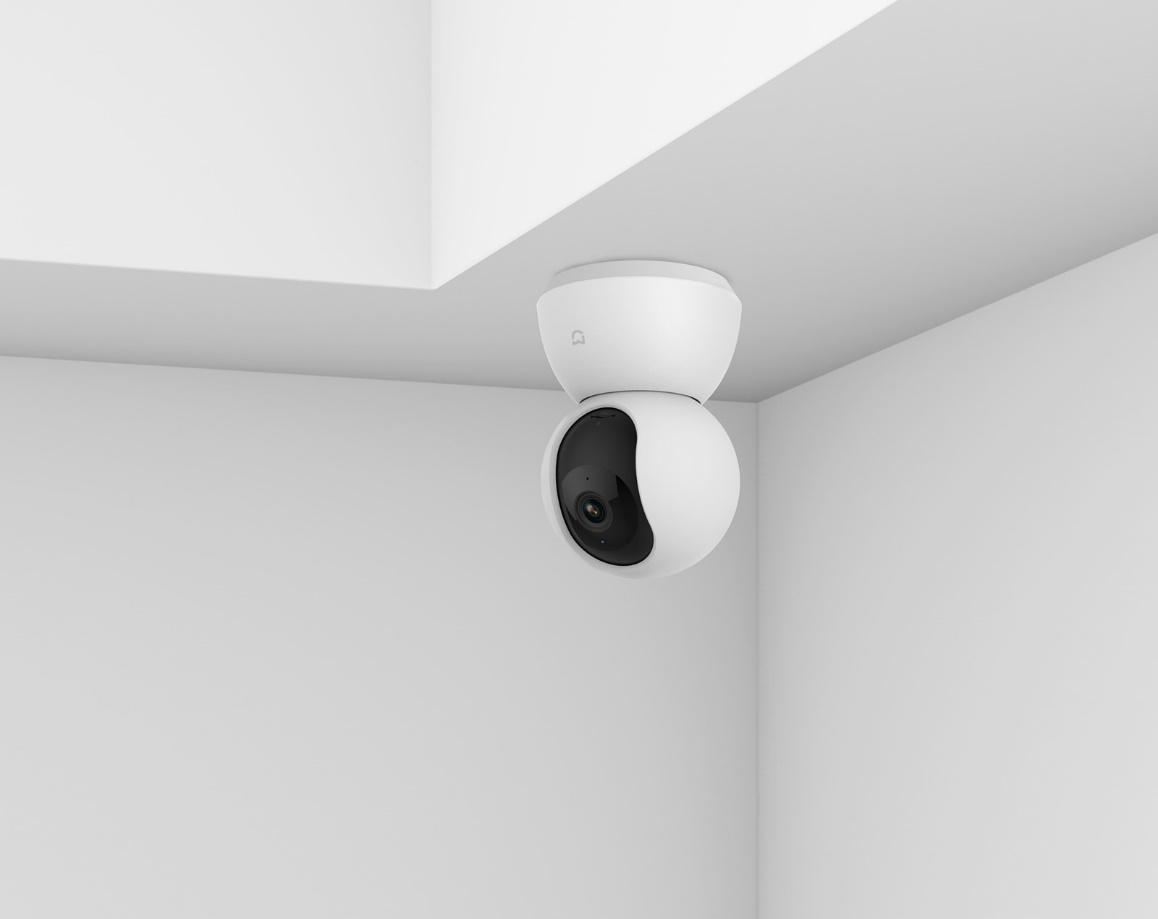 A white ceiling fan  Description automatically generated with low confidence