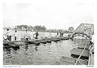 Photo: 22 Mar 1968, Perfume River, Hue, South Vietnam --- Pedestrians make their way up the existing span of the Bach Ho Bridge after carefully crossing the makeshift center span. The bridge near Hue, South Vietnam, had been partially destroyed during the Tet Offensive of the Vietnam War. --- Image by © Bettmann/CORBIS
