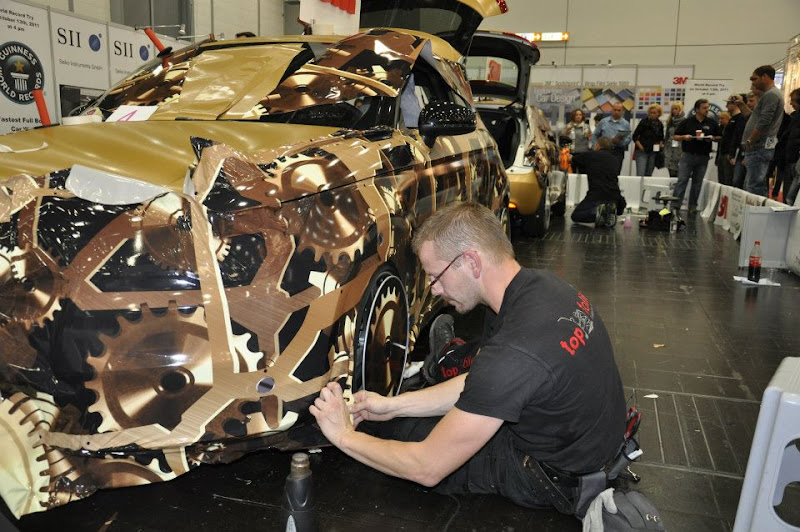 Photo: The fastest time for a team to wrap a full car body is 1 hour 15 minutes 43 seconds and was achieved by folien+zubehör (Germany) at the Messe Düsseldorf in Düsseldorf, Germany.