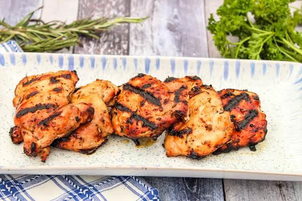 A Platter Of Chicken Thighs Herbs De Provence.