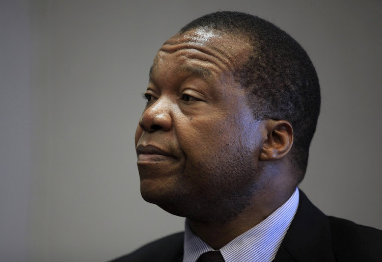 FILE PHOTO: Reserve Bank of Zimbabwe Governor John Mangudya listens to questions during an interview in Harare, March 16, 2016.