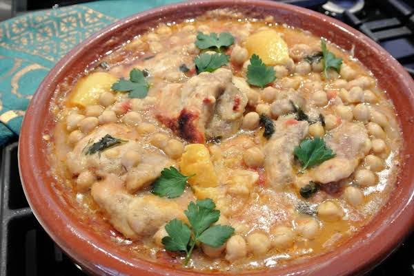 This Is A Moroccan Stew Made With Chicken Thighs, Chick Peas & Preserved Lemons.  Tagine Refers To The Clay Pot In Which It Is Cooked, You Can Develop The Flavors In A Heavy Pot With The Lid Set Slightly Askew And Adjusted Cooking Time.
