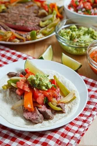 """Fajitas""""Grilled, marinated steak served in warm tortillas with your favourite toppings like..."""