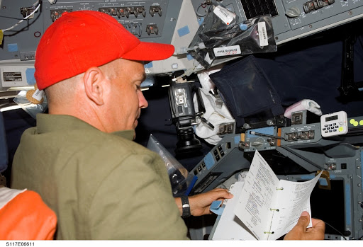 Sturckow looks over procedures on the FD of STS-117 Space Shuttle Atlantis