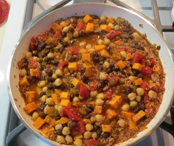 Stir in beans, and raisins. Heat through.