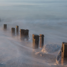 Youghal Strand Groynes 25092017 by John Holmes - Landscapes Waterscapes ( old, ireland, cork, wood, groynes, sea, minimal, no people, weather beaten, long exposure, sunrise, rocks, youghal strand )