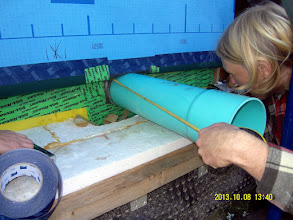 Photo: ... setting the pipe depth in the wall cavity (we're using scraps of 60mil EPDM from the roofing ...