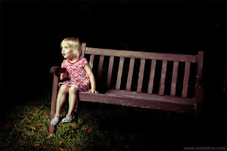 Photo: A little girl in a darkness Looks like she is more curious than afraid. Curiosity is what will lead her through entire life:-)  This was a test shot from one of our old photosets, done it with one strobe (e640) in a shade during bright and sunny day.