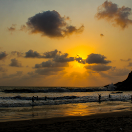 Sunset by Ajith Iddya - Landscapes Beaches ( sunrays, sunset, beach, silhouette, water,  )