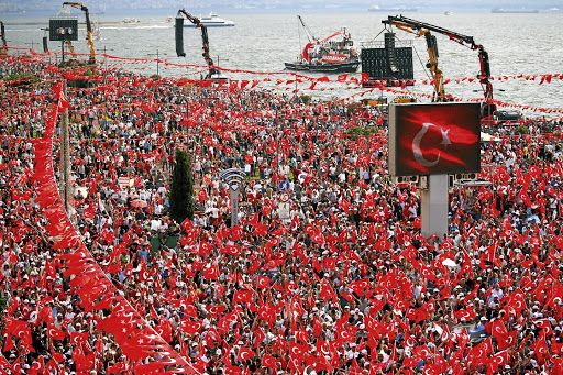 Supporters of opposition candidate Muharrem Ince wave flags during a rally in Izmir, Turkey, on June 21 2018. Turkey is one of the countries where democracy is in retreat. Picture: REUTERS