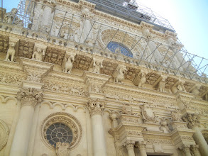 Photo: The most famous church in Lecce, the Basilica of Santa Croce, a baroque extravaganza. Unfortunately, there was scaffolding up on the church this day, and we weren't able to see a lot of the fantastical details ...