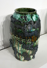 """Photo: """"A Pot a Day, 4/23/11"""" A mixture of earthenware, stoneware, and porcelain with previously fired ceramic pellets, BBs, and brass filings embedded in the surface. A copper oxide wash and a clear glaze are applied to the surface."""