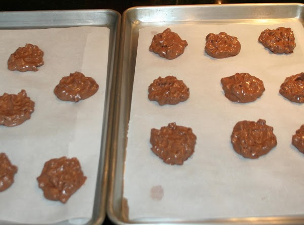 Once your cookies are all measured out, flatten out with the back of a...