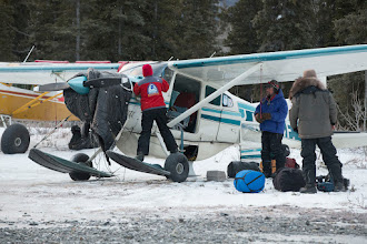 Photo: Volunteer pilot Diana Moroney prepares her plane to move the Iditarod Insider crew Bruce Lee and Bode during the 2014 Iditarod at Rohn.PHOTO BY JEFF SCHULTZ / IDITARODPHOTOS.COM  DO NOT REPRODUCE WITHOUT PERMISSION