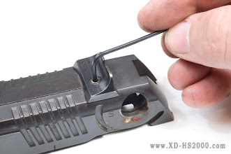 Photo: USe an allen key to loosen the locking screw in the rear sight.