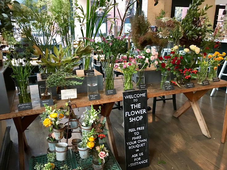 The flower shop at the London Plane.