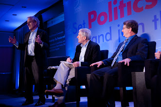 """Photo: Sir Harold Evans makes a point during the """"Austerity: The Promise and Risks"""" panel discussion Friday, Nov. 16, 2012 at the RAND Politics Aside event in Santa Monica, Calif., as Undersecretary Robert Hormats and Stuart Hoffman look on."""