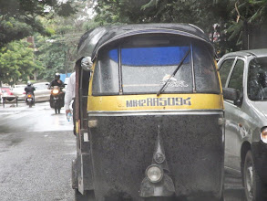 Photo: Just saw a dog getting on to the auto-rickshaw! I was waiting to see the driver-san to come back and be astonished by an unusual passenger.. It was a rainy day, so she also needed an escape. 17th August updated -http://jp.asksiddhi.in/daily_detail.php?id=273