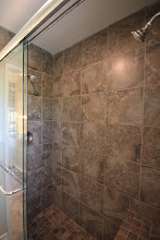 Photo: Double shower head and shower seat in master bath