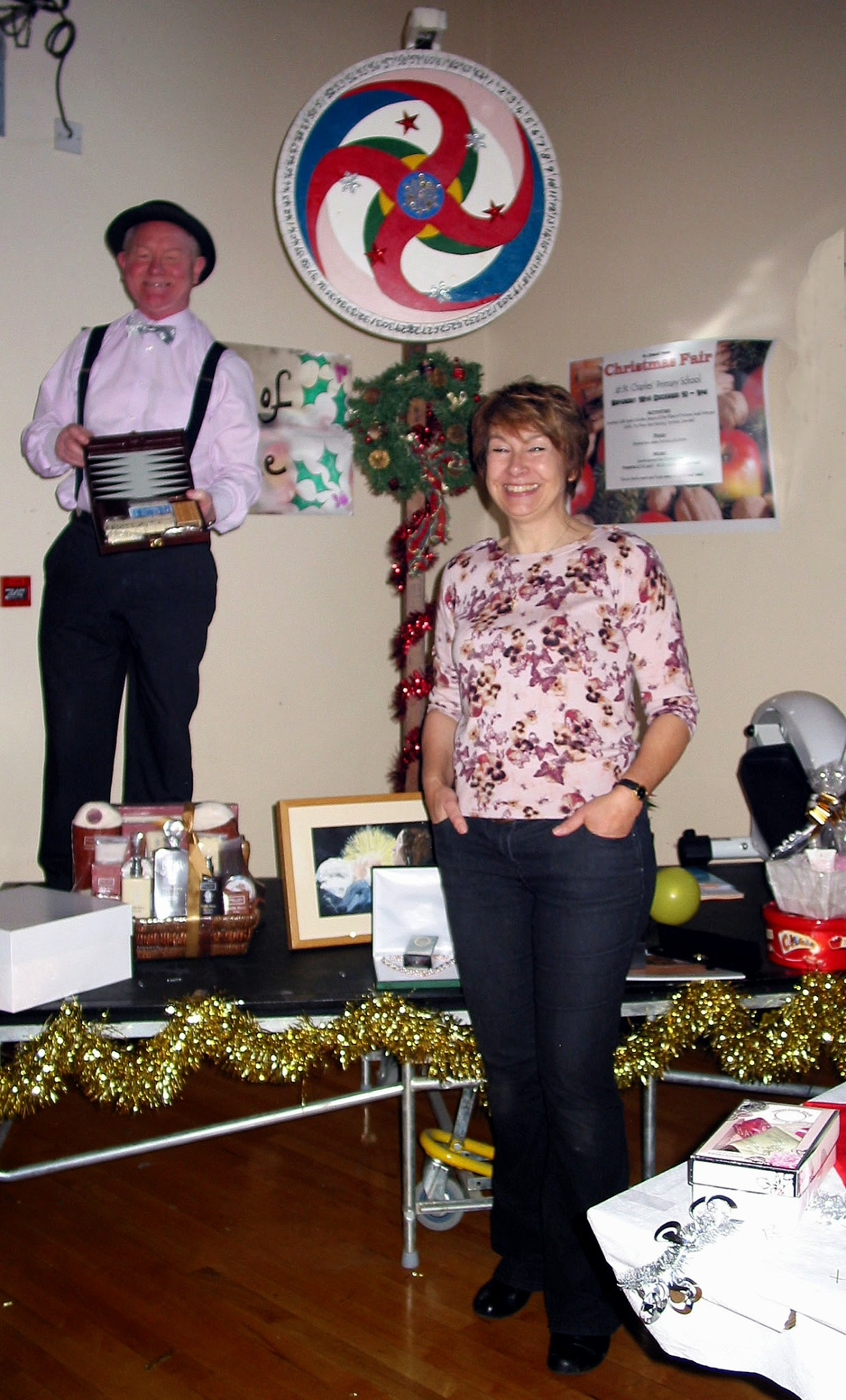 Photo: Karin overseeing that after everyone's hard work all is well & Chris running the Wheel of Fortune.