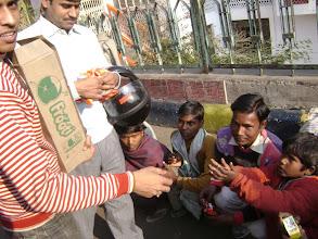 Photo: Team medma distributing etables to poor children.