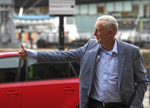 Plan of action: Party leader Jeremy Corbyn arrives at the Albert Dock, ahead of the Labour Party's annual conference in Liverpool. The opposition party announced plans to make British companies transfer shares to workers. The British Chambers of Commerce says the plan could deter people from investing in Britain. Picture: REUTERS