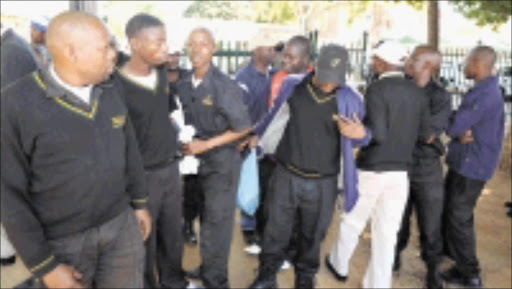JOBLESS: In front of their security company, these Fidelity Security employees in Polokwane in Limpopo are accusing the company fired them through SMS. Pic: ELIJAR MUSHIANA. 03/06/2009. © Sowetan.