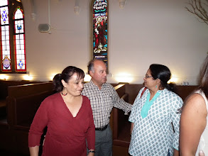 Photo: Debbie receives Noel and Sudha at the church turned Bavarian bar