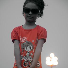 Cute Girl by Umair Nayab - Babies & Children Child Portraits ( child, black background, orange, girl, glasses,  )