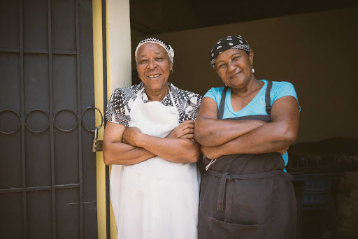 DR-Two-Women-in-Doorway-of-Cacao.jpg - Come meet the locals on a cruise to the Dominican Republic.