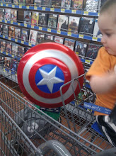 Photo: I thought my son was having fun with his Captain America shield. He was actually trying to avoid the camera.