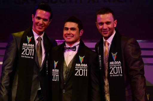Mr Gay South Africa 2011 Lance Weyer (C), flanked by second runner-up Casper Bosman (L) and first runner-up Alexander Steyn (R).