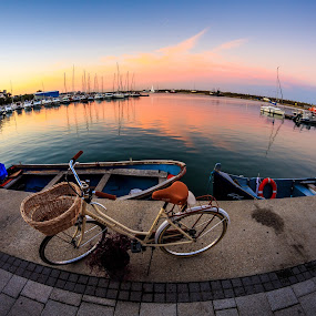 Harbour bike by Adrian Ioan Ciulea - Transportation Bicycles ( fisheye, bike, sunset, harbour, boats, bicycle )