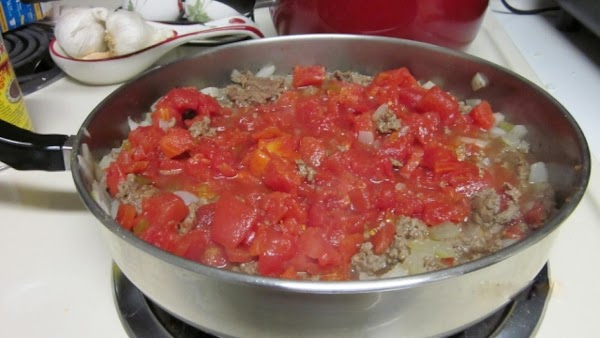Add the can of diced tomatoes and can of Ro-Tel tomatoes and green chilies...