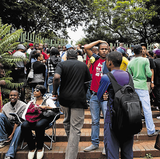 Would-be students at one of the University of Johannesburg's entrances yesterday in the hopes of being allowed to register