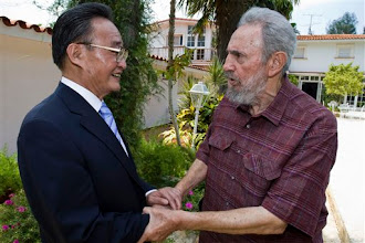 Photo: In this photo released by Cuba's official newspaper Granma, Cuba's leader Fidel Castro, right, greets Wu Bangguo, chairman of China's National People's Congress in Havana, Thursday, Sept. 3, 2009.  (AP Photo/Alex Castro, Granma)