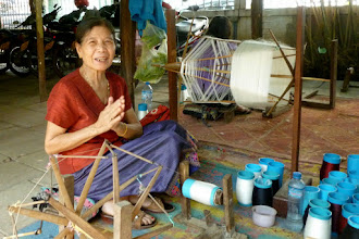 Photo: This lady's job is to wind the silk threads to be used later.