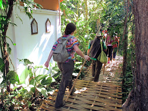 Photo: The hikers start out on their adventure with bamboo walking sticks to help negotiate their way along the rugged trail.