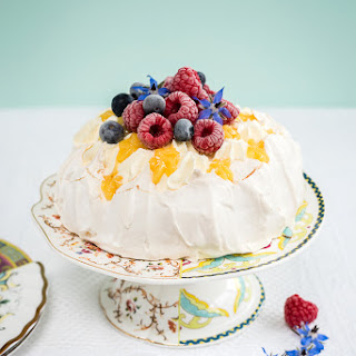 Pavlova Crown With Whipped Cream, Lemon Curd And Fresh Berries.