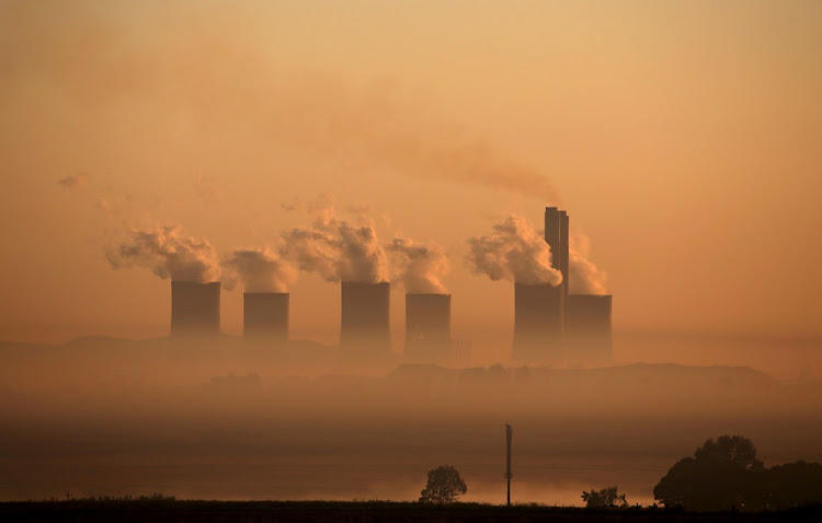 Steam rises at sunrise from the Lethabo Power Station, a coal-fired power station owned by state power utility Eskom near Sasolburg. Matshela Koko' and suspended Eskom chief financial officer Anoj Singh are expected to appear before a parliamentary inquiry into alleged corruption at the power utility.