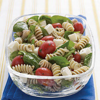 Spinach, Tomato, and Fresh Mozzarella Pasta Salad with Italian Dressing.