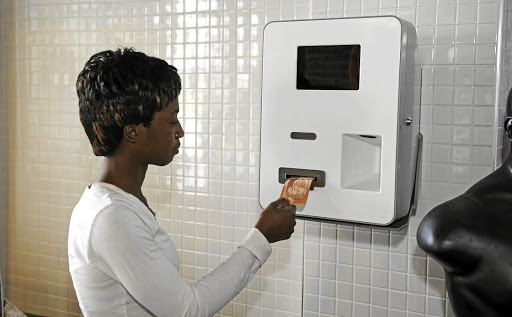 New money: A customer feeds cash into a bitcoin machine in Midrand. Picture: RUSSELL ROBERTS