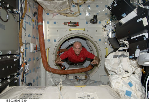 Expedition 21 FE Williams poses for a photo on the Atlantis Middeck