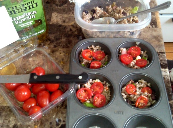 Add one sliced grape tomato into each cup.  Press down, making slight indent...