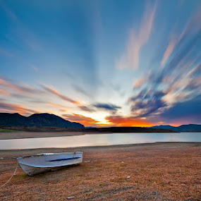 Silent boat by Nikos Koutoulas - Landscapes Sunsets & Sunrises ( βάρκα, exposure, clouds, waterscape, greece, lake, kranidia, κρανίδια, long, boat, κοζάνη, ηλιοβασίλεμα, kozani, sunset, ελλάδα, λίμνη )