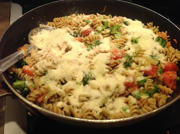 Add in the grated Parmesan and stir until cheese begins to melt into pasta...