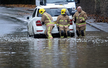 Photo: Fire service personnel remove a car from floodwater near Tetbury, Gloucestershire, as motorists were urged to take greater care on Britain's roads today after overnight downpours caused some drivers to abandon their vehicles as public highways flooded. PRESS ASSOCIATION Photo. Picture date: Wednesday November 21, 2012. See PA story WEATHER Floods. Photo credit should read: Tim Ireland/PA Wire